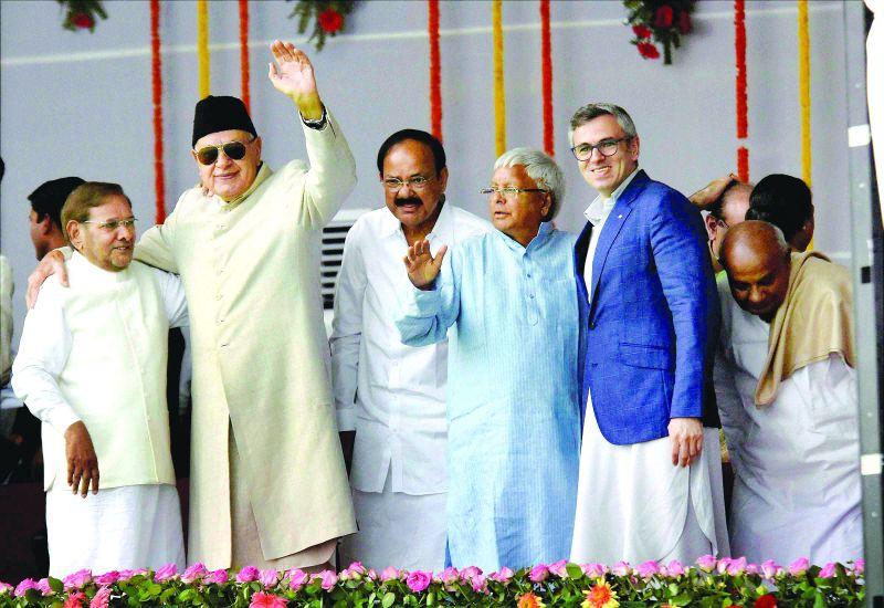 Union minister M. Venkaiah Naidu with RJD chief Lalu Yadav and former J&K CM Omar Abdullah