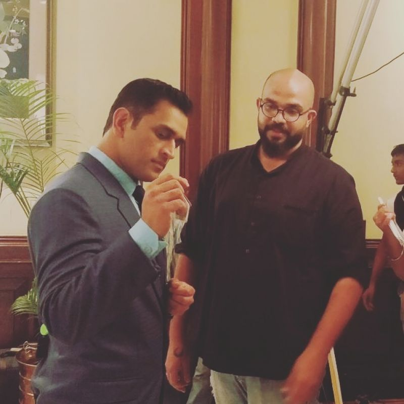 Dhoni and Roy share a light moment together during the shoot.