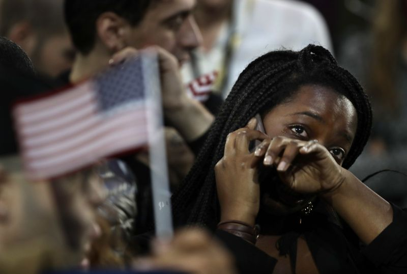 A woman weeps as election results are reported during Democratic presidential nominee Hillary Clinton's election night rally in the Jacob Javits Center glass enclosed lobby in New York.