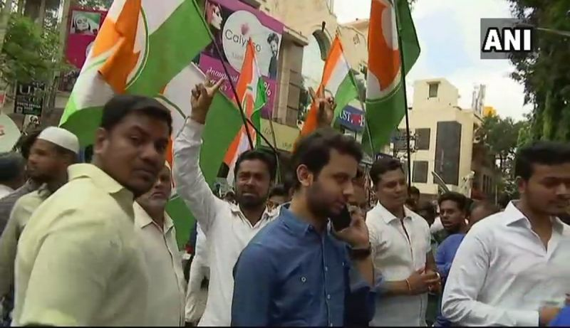 Congress workers celebrate outside counting centre in Bengaluru after party candidate Sowmya Reddy leads over BJP's BN Prahlad in Jayanagar assembly constituency. (Photo: ANI/Twitter)