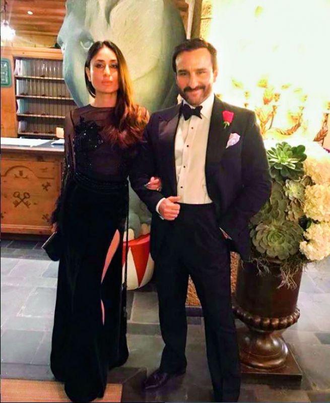 Manish Malhotra captioned this photogprah: The Gorgeous Royal couple #dapper #saifalikhan and the #Beautiful #kareenakapoorkhan in Black #Bespoke #manishmalhotralabel
