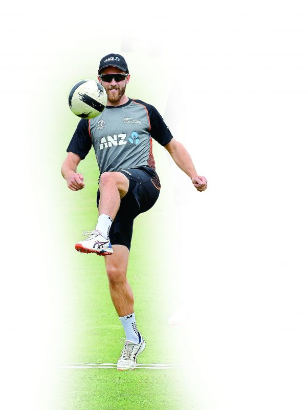 New Zealand captain Kane Williamson plays football as he takes part in a training session at Lord's Cricket Ground in London on Saturday, eve of the World Cup final against England. (Photo: AFP)