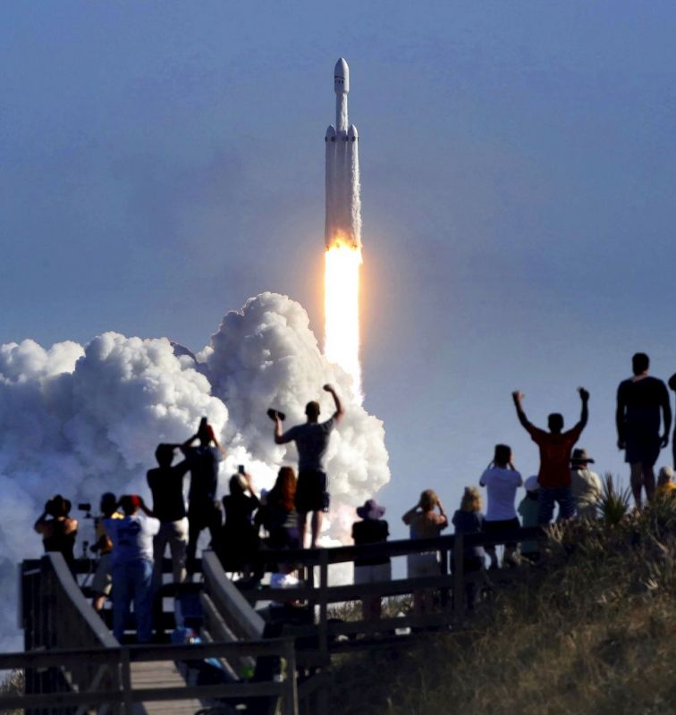 The crowd cheers at Playalinda Beach in the Canaveral National Seashore, just north of the Kennedy Space Center, during the successful launch of the SpaceX Falcon Heavy rocket. Playalinda is one of closest public viewing spots to see the launch, about 3 miles from the SpaceX launchpad 39A.