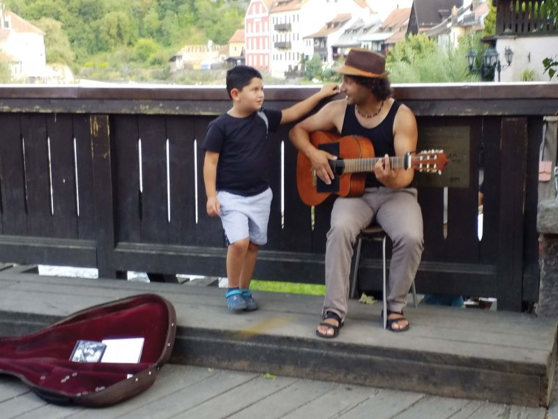 A father and son performing for tourists.