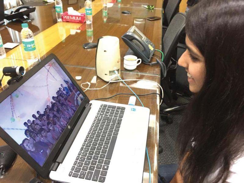 A volunteer teaches rural schoolchildren using Skype