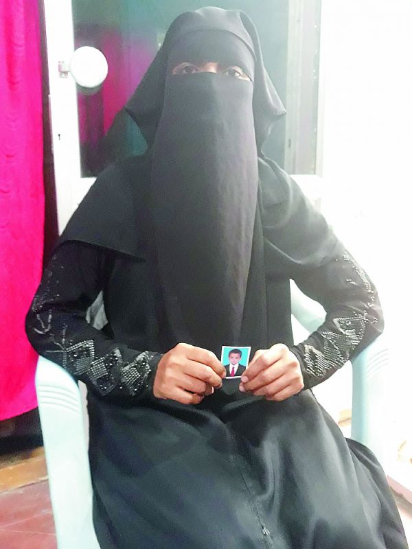 Ms Shaheen holds a picture of her son. She was slapped with a divorce, 15 days post the delivery of her son and is fighting the case she filed against the Karimnagar head Qazi and her in-laws. (Photo: DC)