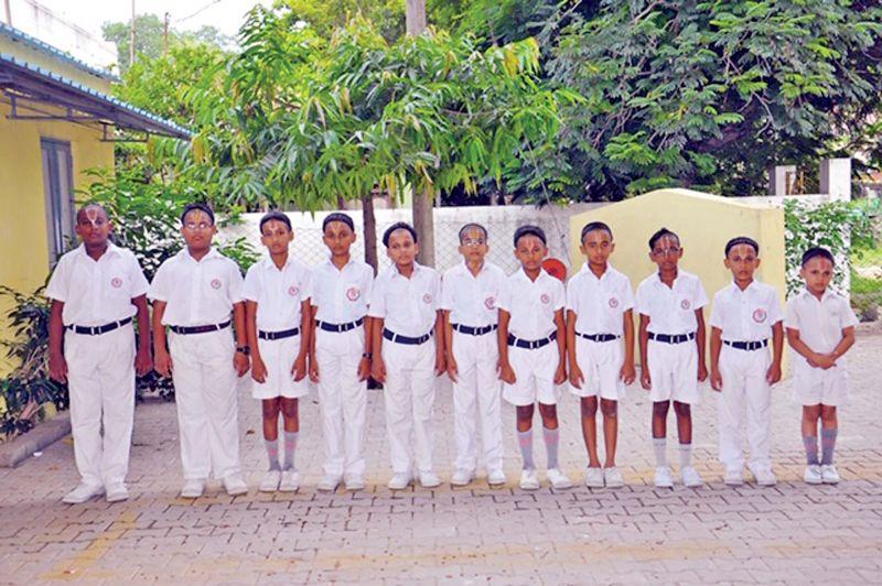 Students in their school uniform.