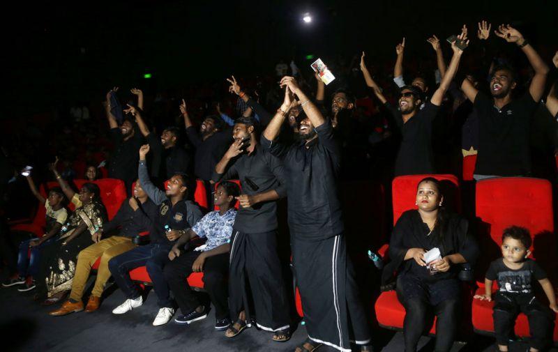Spectators watch 'Kaala', the new film of superstar Rajinikanth in Mumbai. (Photo: AP)