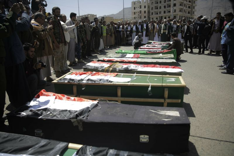 Mourners attend a mass funeral of victims of an explosion during a funeral procession in Sanaa, Yemen.
