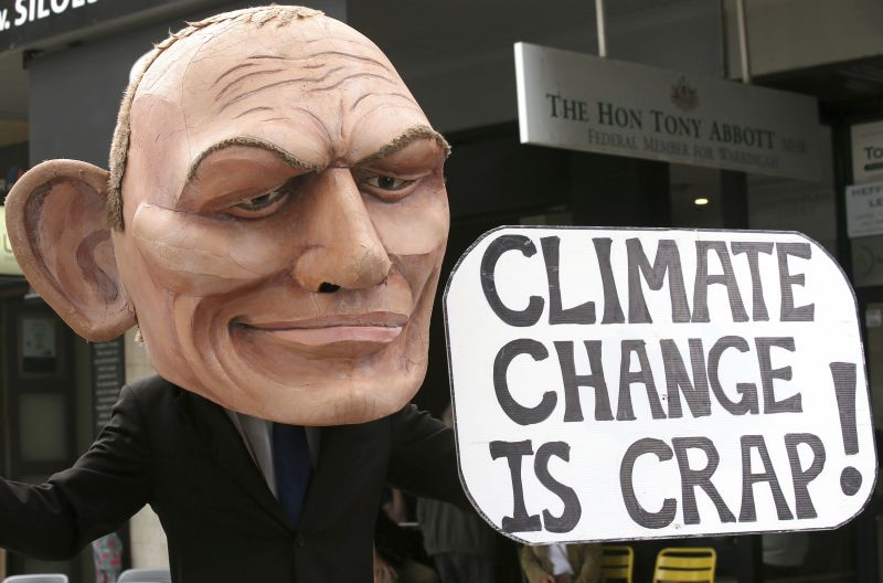 In this May 3, 2019, file photo, a demonstrator with a giant head in the likeness of former Australian Prime Minister Tony Abbott holds a sign referencing a comment by Abbott made in 2017 belittling the science of climate change, during a student organized protest at in Sydney. Australian elections is held on Saturday, May 18, 2019. (Photo:AP)