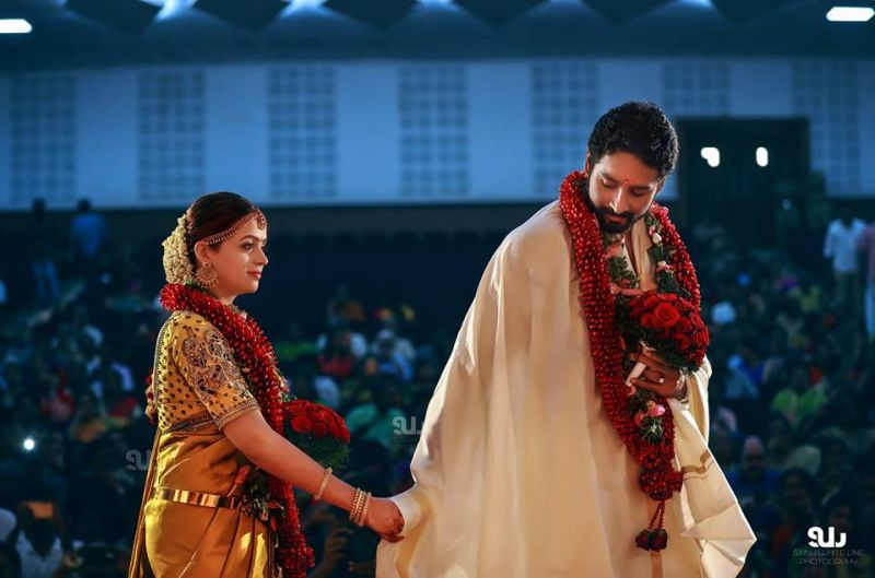 South star bhavana marries long time beau mammootty others attend bhavana donned a traditional golden saree while naveen wore a dhoti as they perform the rituals altavistaventures Image collections
