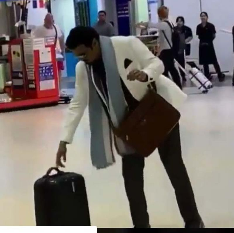 The video shows him in an airport, and the actor is seen shoving his suitcase away from him.