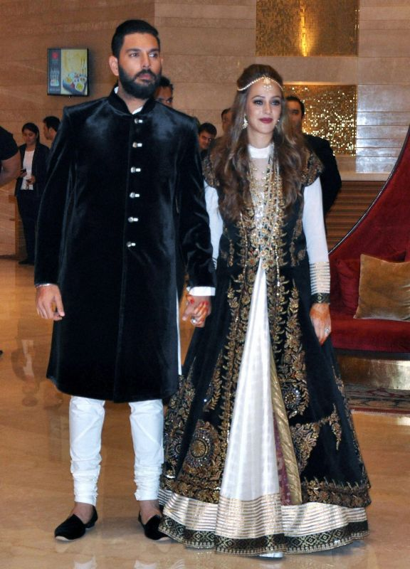 Yuvraj Singh and Hazel Keech could not hide their joy as they exchanged rings. (Photo: PTI)