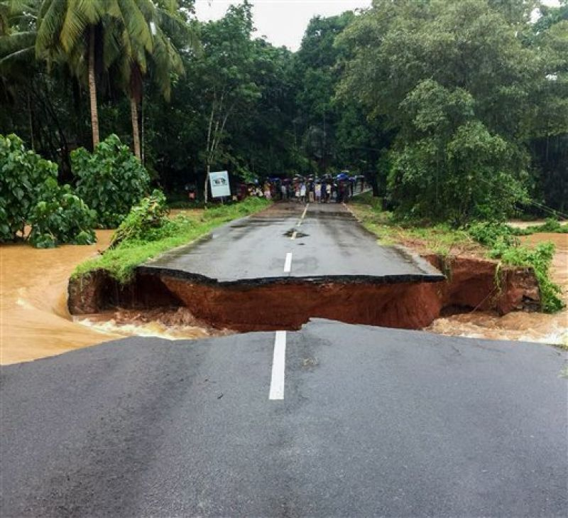 Malappuram: A section of Nilambur- Karad road is seen washed away following a flash flood, triggered by heavy rains, at Malappuram in Kerala. (Photo: PTI)