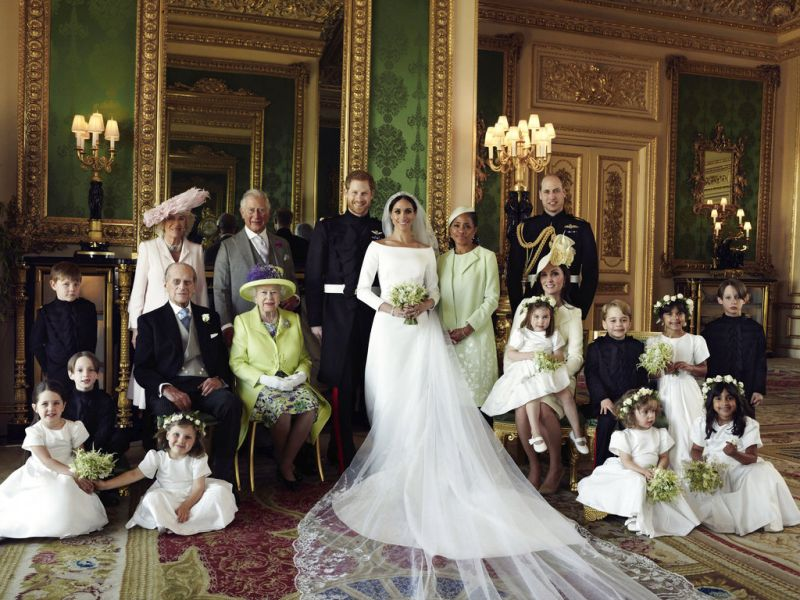 In this photo released by Kensington Palace on Monday May 21, 2018, shows an official wedding photo of Britain's Prince Harry and Meghan Markle, center, in Windsor Castle, Windsor, England, Saturday May 19, 2018. Others in photo from left, back row, Jasper Dyer, Camilla, Duchess of Cornwall, Prince Charles, Doria Ragland, Prince William; center row, Brian Mulroney, Prince Philip, Queen Elizabeth II, Kate, Duchess of Cambridge, Princess Charlotte, Prince George, Rylan Litt, John Mulroney; front row, Ivy Mulroney, Florence van Cutsem, Zalie Warren, Remi Litt. (Photo: AP)