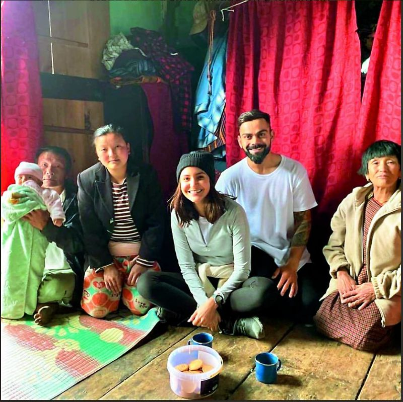 The couple with the family who welcomed them on their trek
