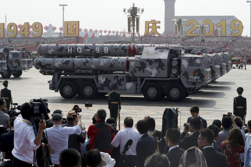 Military vehicles roll down during a parade to commemorate the 70th anniversary of the founding of Communist China in Beijing. (Photo: AP)