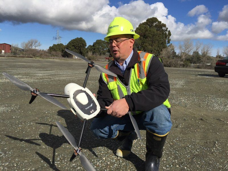 Mike Moy, an assistant plant manager for Lehigh Hanson Cement Group, inspects a Kespry drone he uses to survey inventories of rock, sand and other building materials at a mining plant in Sunol, California.