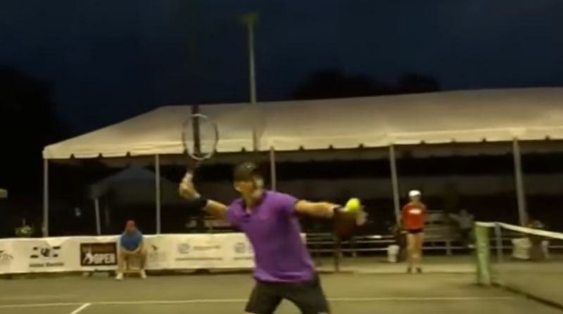 One of the two bemused American players, Mitchell Krueger, whacked a tennis ball far out of bounds toward the source of the racket, which the TV commentator said came from a nearby apartment. (Photo: Screengrab)