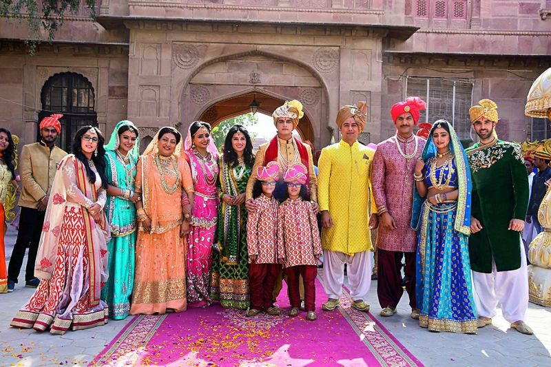 Kartik's family look decked up in the wedding finery, as they are all set to enjoy the grand wedding. Here the family is readying the groom for his baraat.