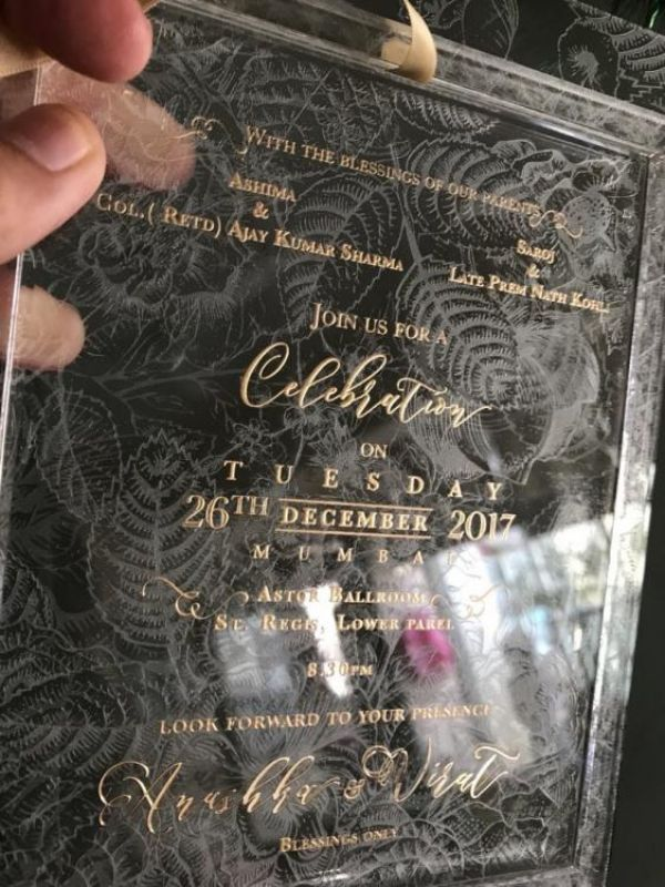 Invitation card venue details of Virat Kohli Anushka Sharma Delhi