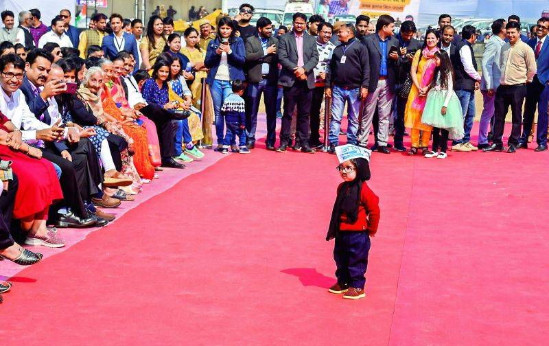 Chotu mufflerman (child dressed as Kejriwal) at Ramlila Maidan in New Delhi on Sunday. (Photo: PTI)