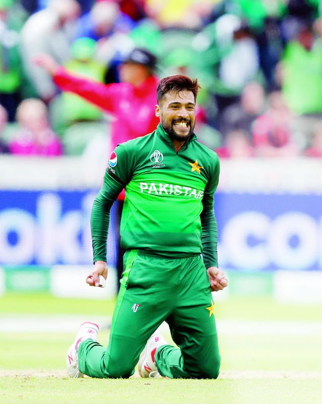 Pakistan pacer Mohammad Amir celebrates taking the wicket of Mitchell Starc during the match against Australia at the County Ground in Taunton on Wednesday. (Photo: AP)