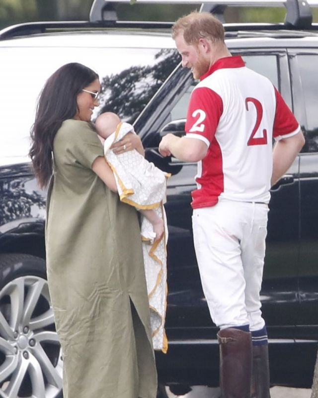Prince Harry seen affectionately patting his son, as Meghan holds the baby. (Photo: Instagram)