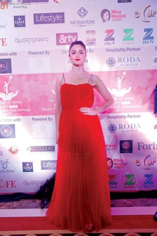 Alia Bhatt matches her red gown with a red lip