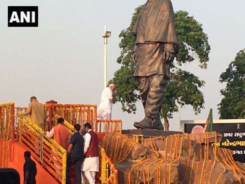 Prime Minister Narendra Modi pays tribute to Sardar Vallabhbhai Patel's statue near the Ahmedabad Airport.  (ANI twitter)