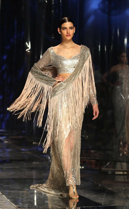 A contemporary, metallic interpretation of the sari with fringes. (Photo: AP)