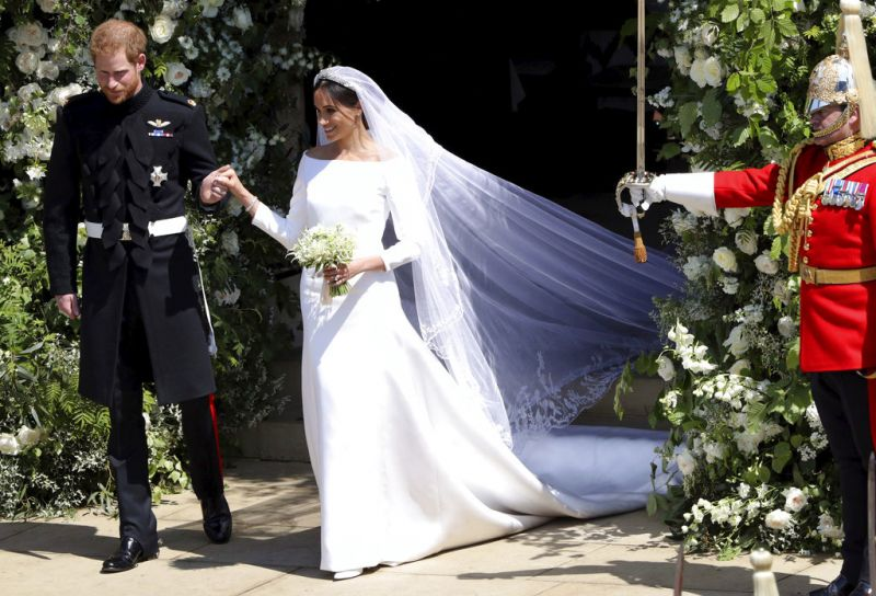 Prince Harry and Meghan Markle leave St George's Chapel after their wedding ceremony, in Windsor Castle. (Photo: AP)