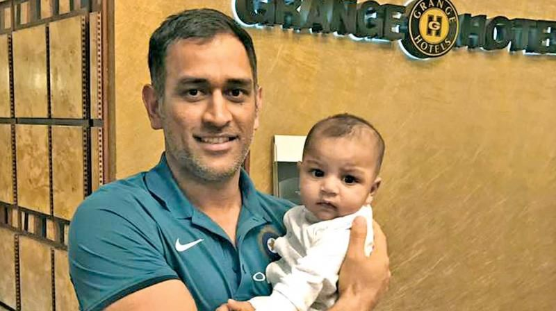 Mahendra Singh Dhoni poses with Pakistan captain Sarfraz Ahmed's son ahead of the India vs Pakistan ICC Champions Trophy clash. (Photo: Twitter)