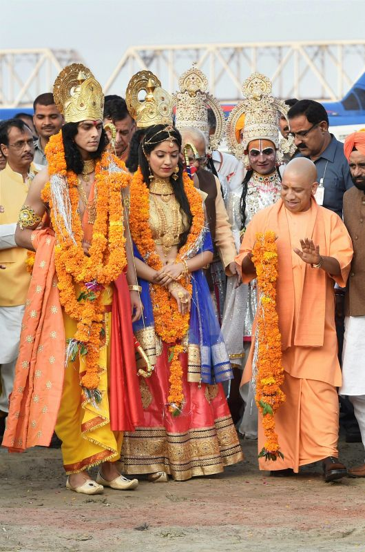 Uttar Pradesh Chief Minister Yogi Adityanath welcoming the artistes dressed up as Lord Rama and Sita during Deepotsav celebrations in Ayodhya on Wednesday. (Photo: PTI)