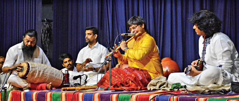 Shashank on flute, U. Rajesh on mandolin and veteran mridangist Karaikudi Mani impress the audience with their performance at the music festival organised by Karthik Fine Arts in the city on Monday.  (Photo: DC)