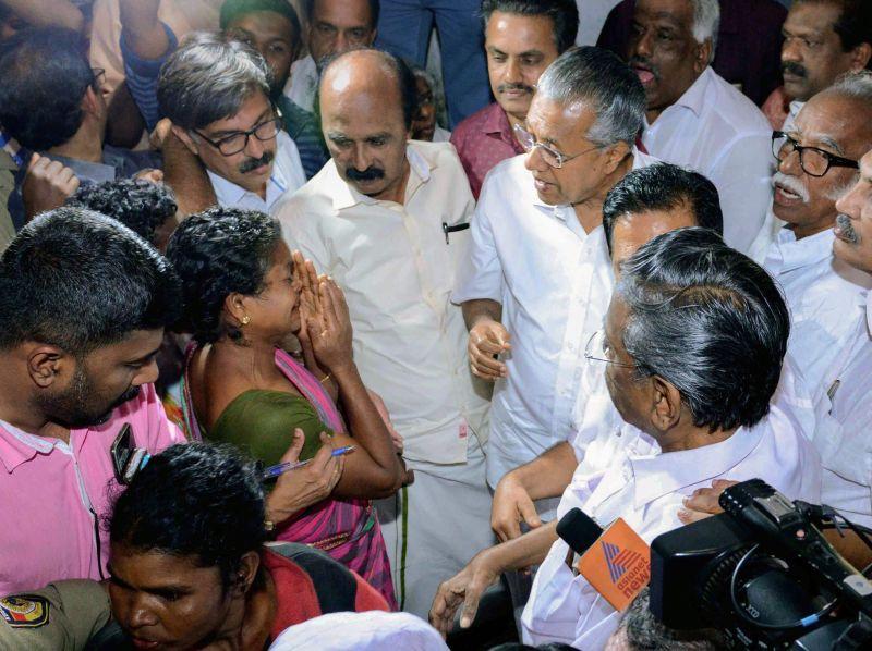 Kerala Chief Minister Pinarayi Vijayan meets the flood-affected people at a Munderi camp in Wayanad on Saturday. (Photo: PTI)