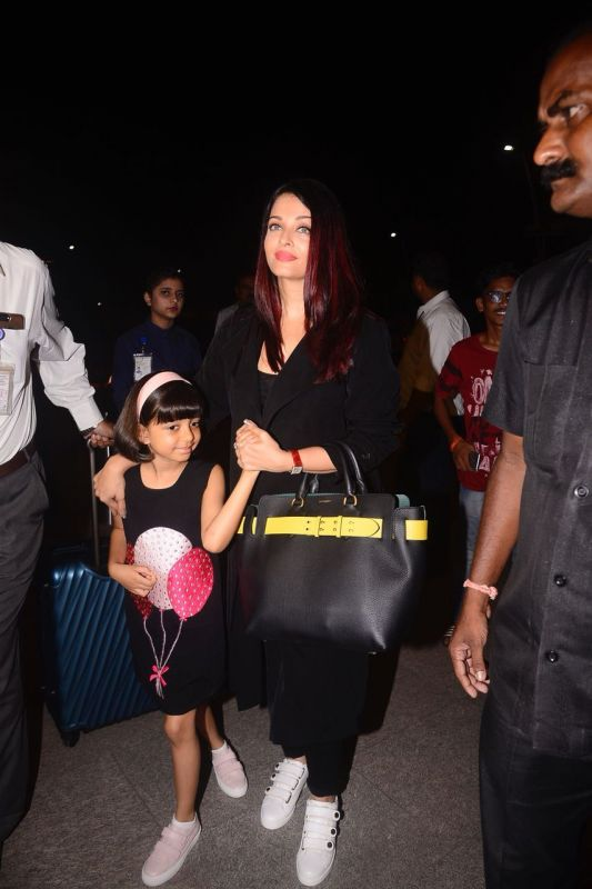 Aishwarya Rai Bachchcan leaves for festival with daughter Aaradhya.