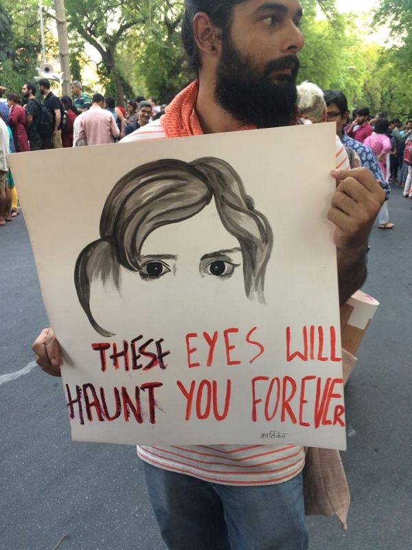Protesters holding placards in Delhi. (Photo: Aditi Yajnik)