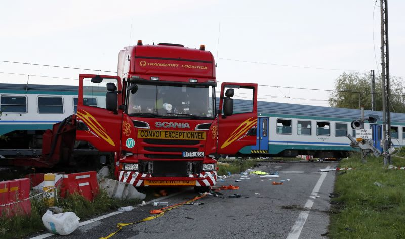 The wreckage of a truck sits next to a railroad crossing where it was hit by a regional train. (Photo: AP)
