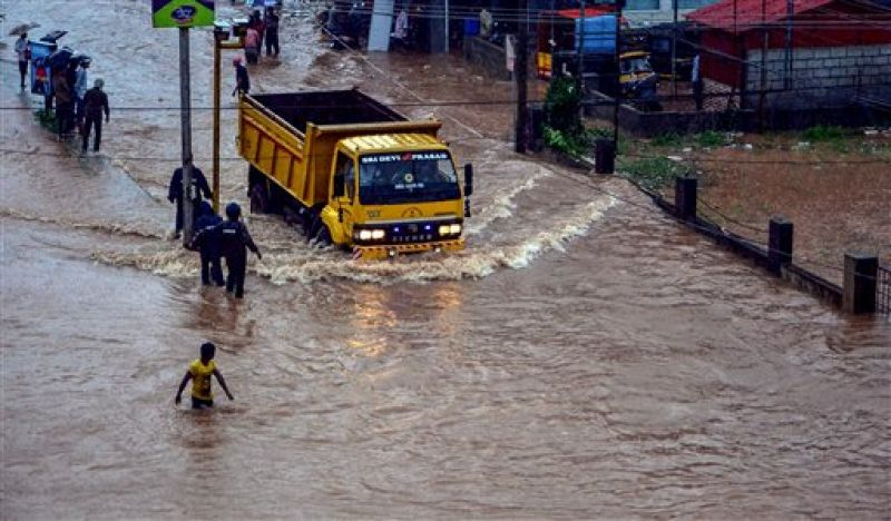 Rescuers at work in a flooded locality after a thunderstorm, in Mangaluru. (Photo: PTI)