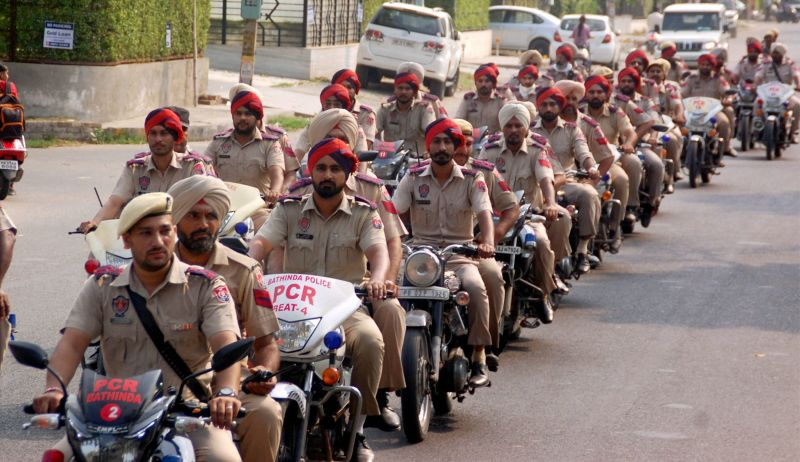 Police personnel march in a street in Bathinda on Monday. The securty has been beefed-up in the city in the view of the verdict in a case against Sirsa-based Dera Sacha Sauda chief Gurmit Ram Rahim Singh likely to be announced on August 25. (Photo: PTI)