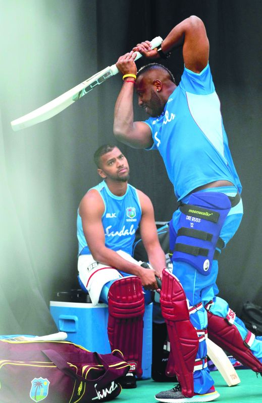 Andre Russell (right) of the West Indies is watched by teammate Nicholas Pooran at a training session at the Rose Bowl in Southampton on Thursday. (Photo: AFP)
