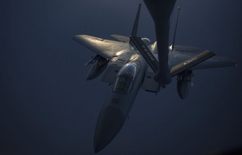 In this Sunday, May 12, 2019 photo released by the U.S. Air Force, an F-15C Eagle receives fuel from a KC-135 Stratotanker from the 28th Expeditionary Aerial Refueling Squadron, at an undisclosed location. The White House ordered the USS Abraham Lincoln aircraft carrier strike group and B-52 bombers to the Persian Gulf region on May 4. (Senior Airman Keifer Bowes, U.S. Air Force via AP)