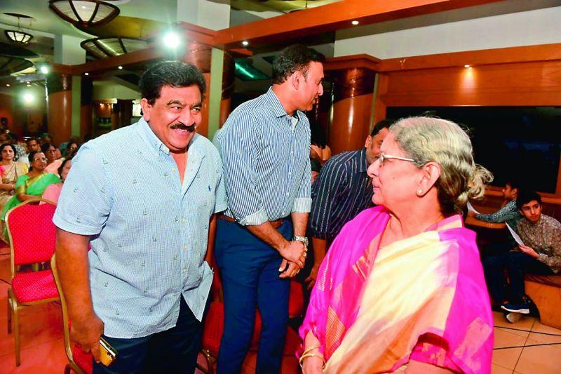 Former cricketer and administrator V. Chamundeswarnath greets late M. V. Sridhar's mother Dr Pushpa.