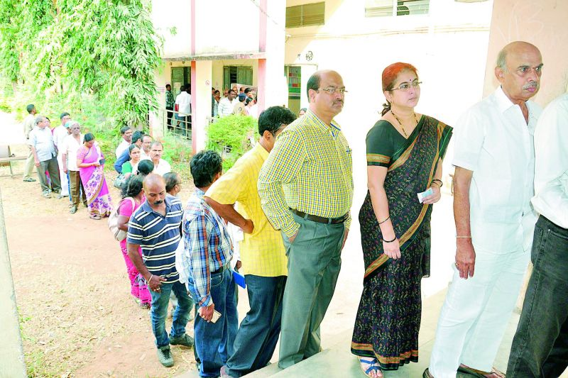 eople stand in a queue to cast their vote for Graduates' MLC polls at VS Krishna College in Vizag on Thursday.