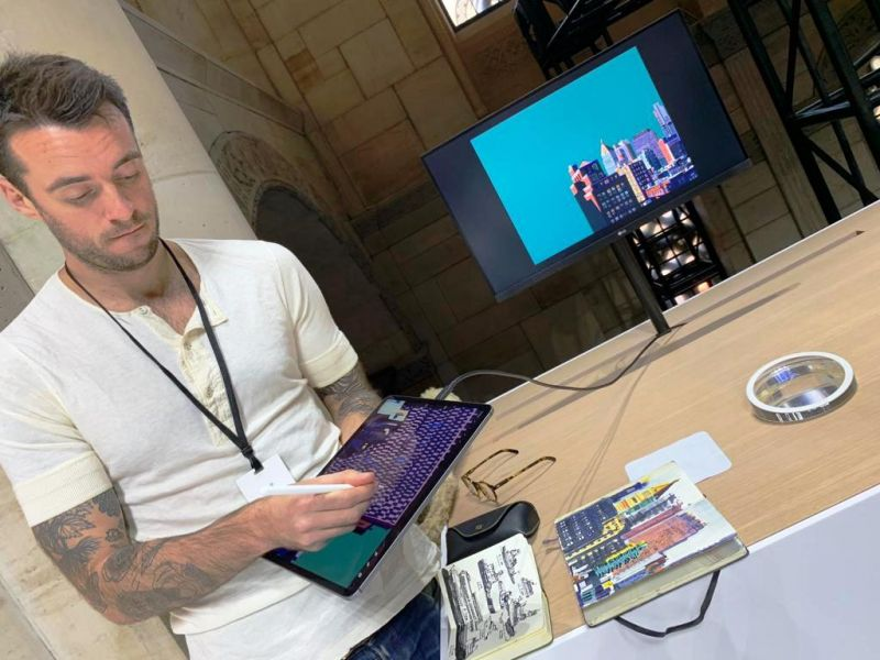 The USB-C port makes it easy for professionals to connect the iPad to bigger displays. Seen here is an artist showing his work live on a secondary display via the USB-C port.
