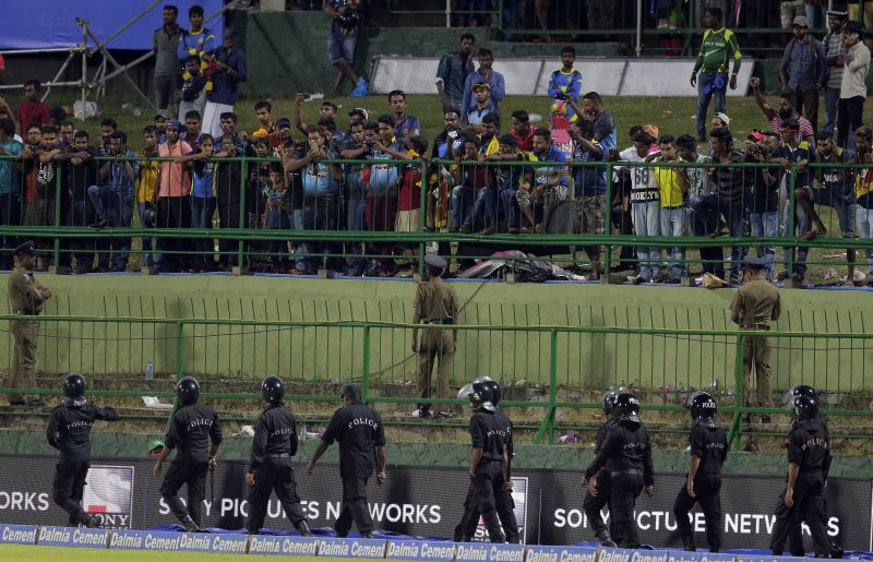 Security forces were called to clear the spectators from some of the sections in the gallery before the match resumed. (Photo: AP)