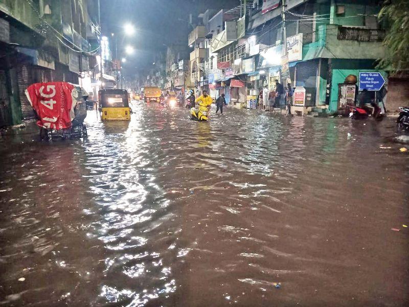 Heavy water-logging due to recent showers affects people on Dr Besant Road in Triplicane, Chennai, on Tuesday.  (Photo: DC)