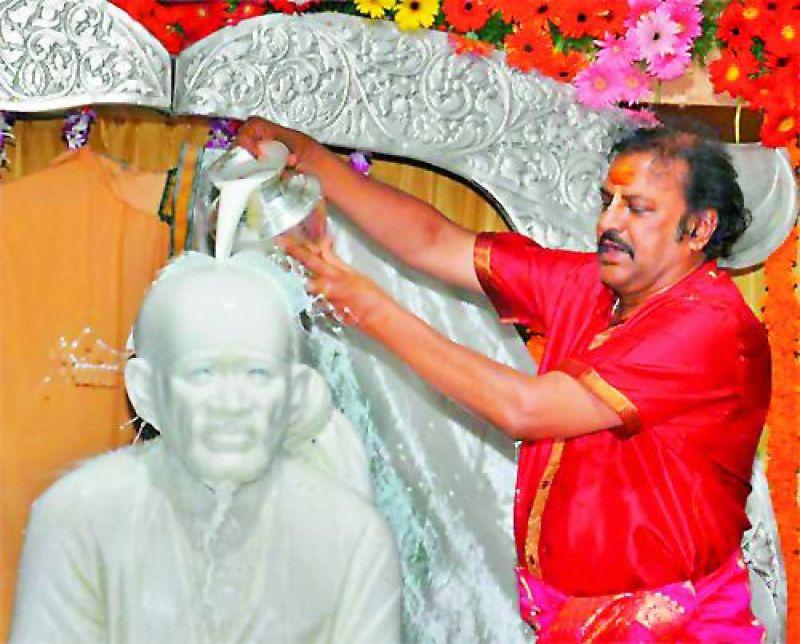 Mohan Babu performs abhishekam on Guru Poornima at Film Nagar.