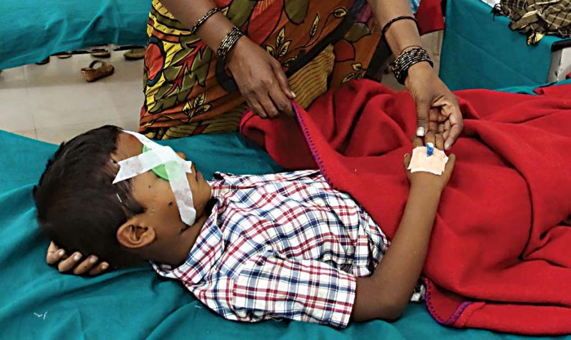 A boy who got injured while bursting crackers, undergoing treatment at Minto eye hospital in Bengaluru on Thursday —KPN